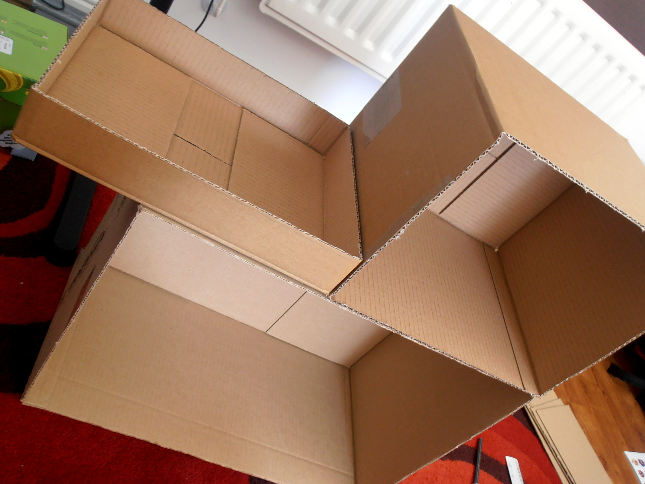 cardboard boxes, doll house skeleton